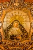 SEVILLE, SPAIN - OCTOBER 29, 2014: The ceramic tiled, cried Madonna on the facade of church Iglesia San Bonaventura by Enrique Orce Marmol (1951). — Stock Photo