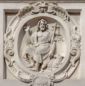 Bruges - The relief of st. John the Baptist on he facade of baroque Carmelites church. — Stock Photo