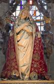 MECHELEN, BELGIUM - JUNE 14, 2014: The carved statue of the Lady of Sorrow in the coat in church Our Lady across de Dyle. — Stock Photo