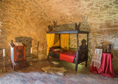 SPISSKY CASTLE, SLOVAKIA - JULY 19, 2014: The medieval bedroom in the castle. — Stock Photo