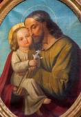 PADUA, ITALY - SEPTEMBER 9, 2014: The saint Joseph with the child paint from side altar in church Basilica del Carmine by unknown painter. — Stock Photo