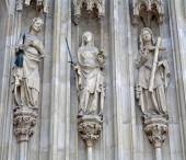 VIENNA - JANUARY 15: Three cardinal virtues from west portal of Minoriten gothic church  on January 15, 2013 in Vienna. — Stock Photo