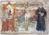 BERGAMO - JANUARY 26: Fresco of Crucifixion from church Michele al pozzo bianco. Frescos of main nave is from year 1440 on January 26, 2013 in Bergamo, Italy. — Stock Photo