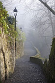 Bergamo - ascent to upper town in winter fog — Stock Photo