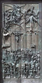 MADRID - MARCH 10: Modern bronze gate of Almudena cathedral by artist Consuelo Perea - facade de Balien in March 10, 2013 in Spain. — Stock Photo