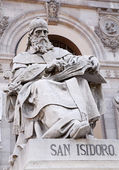 MADRID - MARCH 11: Saint Isidore of Seville from Portal of National Archaeological Museum of Spain projected by architect Francisco Jareno and built from 1866 to 1892 on March 11, 2013 in Madrid. — Stock Photo