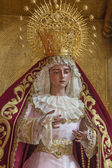 SEVILLE, SPAIN - OCTOBER 28, 2014: The detail of typically vested, cried Virgin Mary statue in church Iglesia de San Roque. — Stock Photo