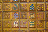 SEVILLE, SPAIN - OCTOBER 28, 2014: The mudejar wooden ceiling in Casa de Pilatos with the arms. — Stock Photo