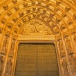 SEVILLE, SPAIN - OCTOBER 28, 2014: The main west portal (Puerta de la Asuncion) of Cathedral de Santa Maria de la Sede by Pedro de Toledo, J. de Hoces, F.de Rosales for neo-gothic part. — Stock Photo #60485405