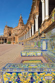 SEVILLE, SPAIN - OCTOBER 27, 2014: Plaza de Espana square designed by Anibal Gonzalez (1920s) in Art Deco and Neo-Mudejar style and tiled 'Province Alcoves' along walls realized by Domingo Prida. — Stock Photo