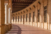 SEVILLE, SPAIN - OCTOBER 28, 2014: The porticoes of Plaza de Espana square designed by Anibal Gonzalez (1920s) in Art Deco and Neo-Mudejar style. — Stock Photo