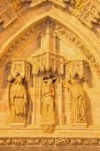 SEVILLE, SPAIN - OCTOBER 28, 2014: The detail of portal Puerta de Bautismo (Baptism of Christ) from 15. cent by N. Martinez and J. Norman on the Cathedral de Santa Maria de la Sede. — Stock Photo