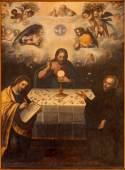 SEVILLE, SPAIN - OCTOBER 29, 2014: The paint Jesus with the Eucharist and St. Ignace and st. John the Evangelist in church Iglesia de la Anunciacion from year 1617 cent. by unknown painter. — Stock Photo
