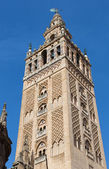 Seville - Giralda bell tower Cathedral de Santa Maria de la Sede decorated with mudejar motives. — Stock Photo