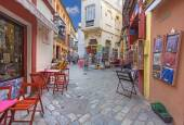 SEVILLE, SPAIN - OCTOBER 28, 2014: Little streets with the shops and restaurants in the Santa Cruz district - Calle Ximenez de Enciso street. — Stock Photo