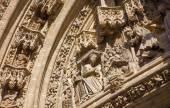 SEVILLE, SPAIN - OCTOBER 28, 2014: The Nativity scene on the Puerta San Miguel on the Cathedral de Santa Maria de la Sede by Nicolas Martinez y Juan Norman from 15. cent. — Stockfoto