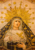 SEVILLE, SPAIN - OCTOBER 29, 2014: The ceramic tiled, cried Madonna on the facade of church Iglesia San Bonaventura by Enrique Orce Marmol (1951). — Stock Photo