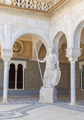 SEVILLE, SPAIN - OCTOBER 28, 2014: The copy of antique statue of Athena in the Courtyard of Casa de Pilatos . — Stock Photo