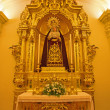 SEVILLE, SPAIN - OCTOBER 28, 2014: The baroque side altar of Virgin Mary in the Capilla de la Universidad (Chapel of University). — Stock Photo #63484867