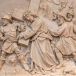 VIENNA, AUSTRIA - DECEMBER 17, 2014: Simon of Cyrene help Jesus to carry his cross. Relief as one part of Cross way cycle in Sacre Coeur church by R. Haas from end of 19. cent. — Stock Photo #63506401