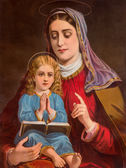 SEBECHLEBY, SLOVAKIA - JANUARY 2, 2015: Typical catholic image of st. Ann with the little Mary from Slovakia (in my own home) printed in Germany from end of 19. cent. originally by unknown artist. — Stockfoto