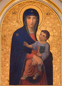 VIENNA, AUSTRIA - DECEMBER 17, 2014: The Madonna paint by Josef Kastner the older from 20. cent in the church Muttergotteskirche as the copy of famous Madonna in Santa Maria Maggiore basilica in Rome — Stock Photo