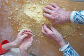 Hands of grandmother and grandchild at cooking — Stock Photo