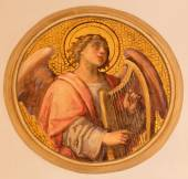 VIENNA, AUSTRIA - DECEMBER 17, 2014: The fresco of angel with the zither by Josef Kastner the younger from 20. cent in the church Muttergotteskirche. — Stock Photo