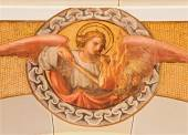 VIENNA, AUSTRIA - DECEMBER 17, 2014: The fresco of angel with the fire by Josef Kastner the younger from 20. cent in the church Muttergotteskirche. — ストック写真