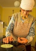 Old woman with the old gramophone — Stock Photo