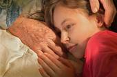 Hands of grandmother and granddaughter in the morning — Stock Photo