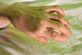 Hand of old woman on the bed — Stock Photo