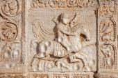 VERONA - JANUARY 27: Relief of rider on the facade of romanesque Basilica San Zeno. Reliefs is work of the sculptor Nicholaus and his workshop on January 27, 2013 in Verona, Italy. — Stock Photo