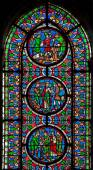 PARIS, FRANCE - JUNE 16, 2011: The windowpane from Saint Denis gothic church with the scenes from French history. — Stock Photo