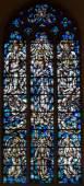 ANTWERP, BELGIUM - SEPTEMBER 6: Modern windowpane of coronation of Virgin Mary in Saint Willibrordus church on September 6, 2013 in Antwerp, Belgium — Stock Photo