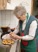 Grandmother and a cakes — Stock Photo