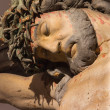BANSKA STIAVNICA, SLOVAKIA - FEBRUARY 5, 2015: The detail of carved statue of Christ on the cross as the part of baroque Calvary from years 1744 - 1751. — Stock Photo #77439550