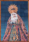 GRANADA, SPAIN - MAY 30, 2015: The ceramic tiled, cried Madonna on the facade of St. Cecilio church by Juan and Emilio Palacios. — Stock Photo