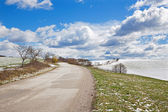 Slovakia - The road in the spring country of Plesivecka Planina plateau. — Stock Photo