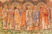ROME, ITALY - MARCH 24, 2015: The mosaic of saints big teachers of Catholic church by Edward Burne-Jones (1833 - 1898) in main apse of anglicans church Chiesa di San Paolo dentro le Mura. — Stock Photo