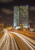 TEL AVIV, ISRAEL - MARCH 2, 2015: The skyscrapers of Azrieli Center at night by Moore Yaski Sivan Architects with measuring 187 m (614 ft) in height. — Zdjęcie stockowe