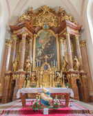 TRNAVA, SLOVAKIA - MARCH 3, 2014: Main altar (1755-1757) in Jesuits church. — Stock Photo