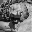BANSKA STIAVNICA, SLOVAKIA - FEBRUARY 5, 2015: The detail of carved statue of Christ on the cross as the part of baroque Calvary from years 1744 - 1751. — Stock Photo #77737098