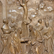 VIENNA, AUSTRIA - FEBRUARY 17, 2014: Stone relief from back side of Church of the Teutonic Order or Deutschordenkirche (1524) with the central scene as Jesus heal the woman. — Stock Photo #77763756