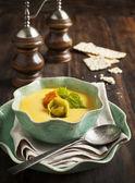 Pumpkin cream soup with cheese tortellini — Stock Photo