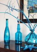 Still life with bottles in blue tones. Interior decoration object — Stock Photo