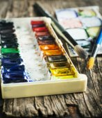 Used water-color paint-box and paint brush. Selective focus — Stock Photo