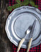 Vintage silverware on rustic metal plate for Christmas Dinner — Stock Photo