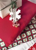 Christmas pillows closeup and Christmas vintage ornament — Stock Photo