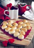 Pie in the shape of heart made from yeast roll buns — Stock Photo